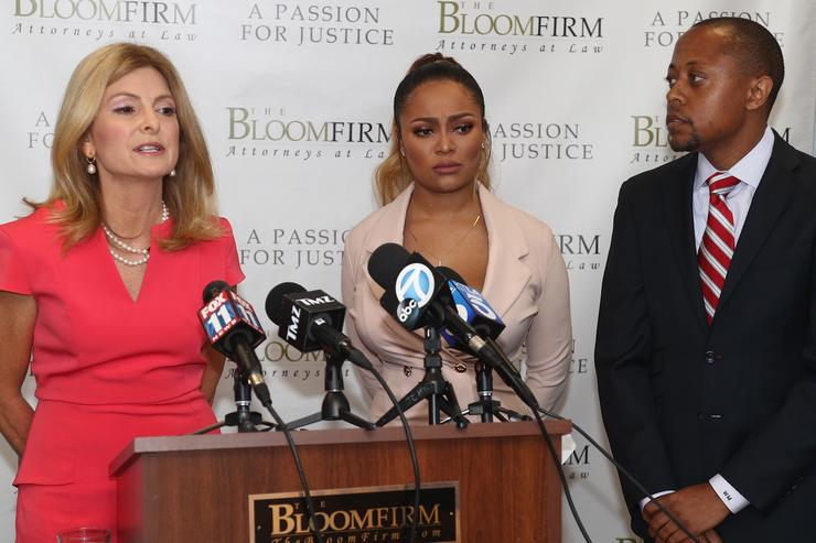 Attorneys Lisa Bloom, speaking, and Walter Mosely hold a press conference with their client Teairra Mari (C) about new legal action against rapper 50 Cent and Akbar Abdul-Ahad at The Bloom Firm on May 17, 2018 in Woodland Hills, California. Mari's former boyfriend Abdul-Ahad allegedly posted a sexually explicit photo of her to her Instagram account after they broke up and 50 Cent reportedly reposted the image.