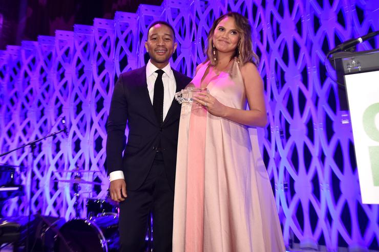 John Legend (L) and Chrissy Teigen speak onstage during City Harvest's 35th Anniversary Gala at Cipriani 42nd Street on April 24, 2018 in New York City.