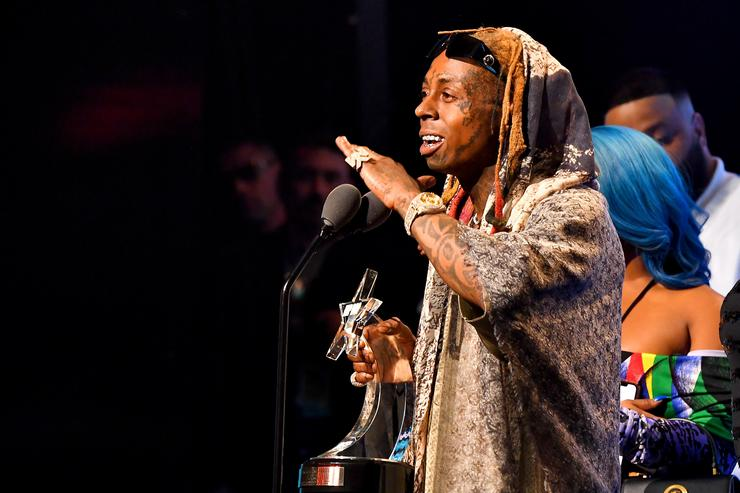 d67ec94323b5 Rapper Lil Wayne onstage during the BET Hip Hop Awards 2018 at Fillmore  Miami Beach on