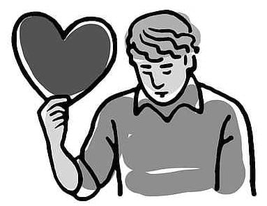 Young Man Holding Heart in Hand