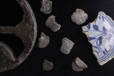 Shipwreck artifacts - coins & a plate fragment.