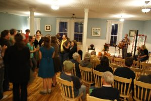 Students enjoying a communtiy dance party in the Dining Room