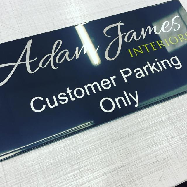 Matching customer car parking signs for Adam James Interiors, Cardiff