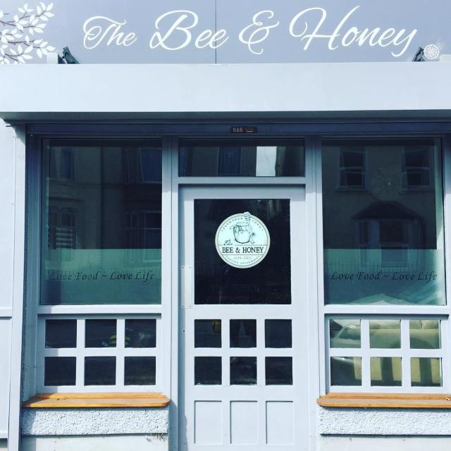 Window graphics at the Bee & Honey, Canton ready to open Tuesday