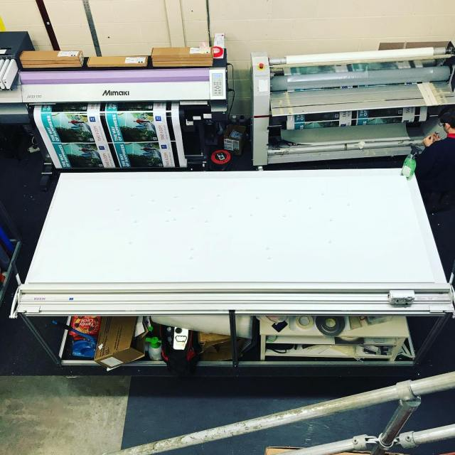 Busy morning: another tray sign with stand off letting being produced, the @mimakiusa printer busy printing and the laminator being set up
