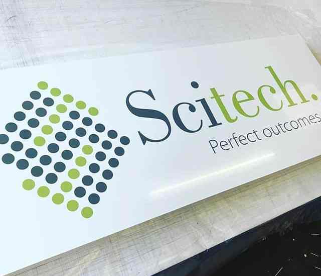 Print and cut artwork laid on to white aluminium composite tray sign for SciTech