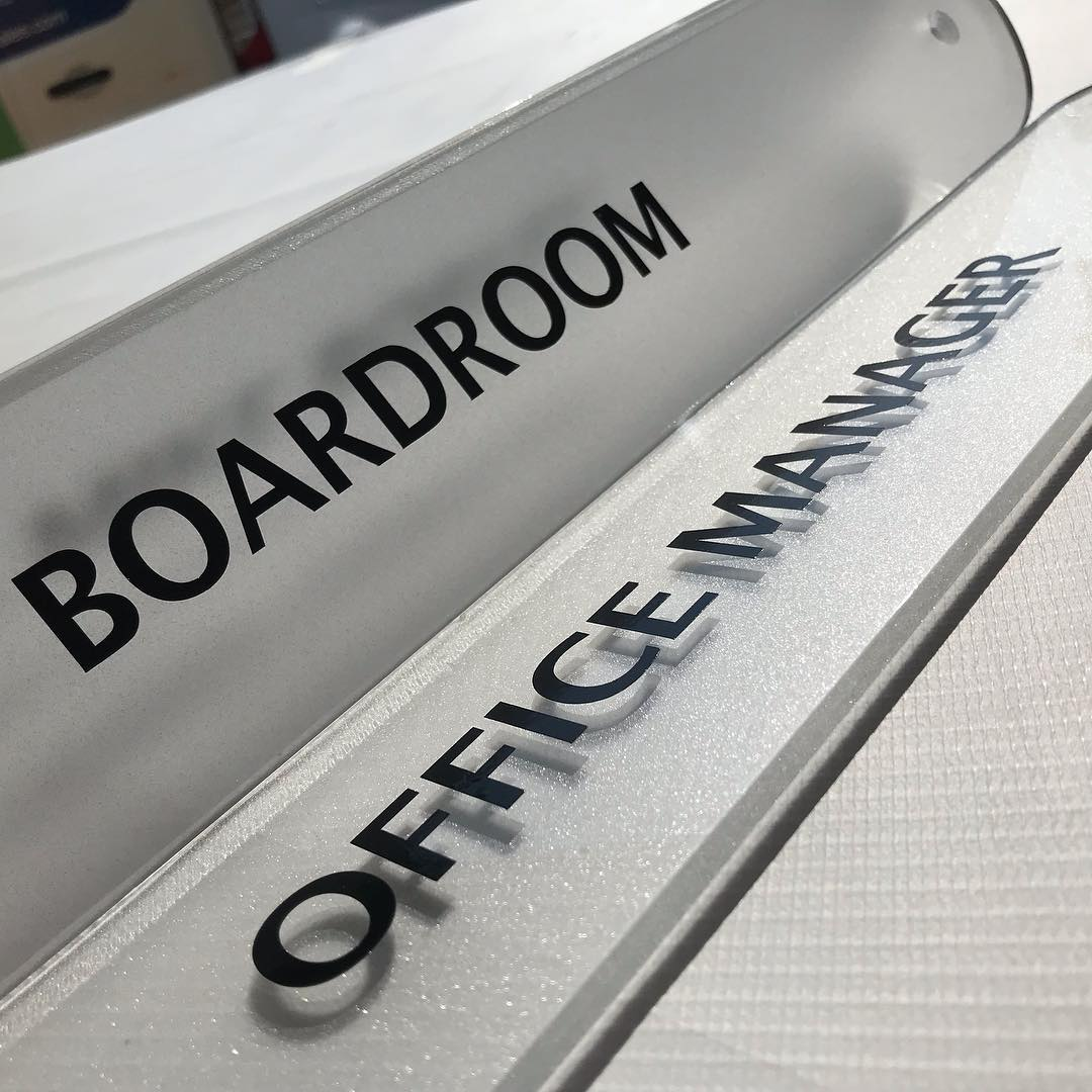 Flame polished clear acrylic door plaques rear decorated with frosting and vinyl applied to the front. Looking very plush