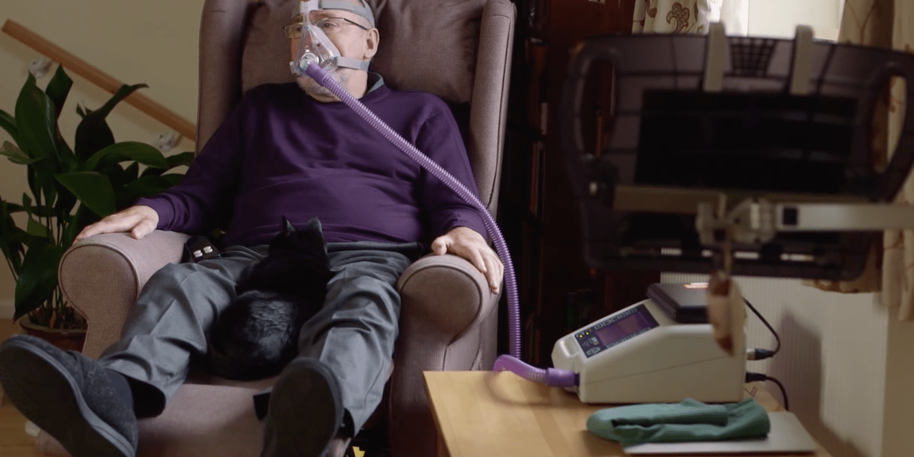 Noel Conway at home with his ventilator on