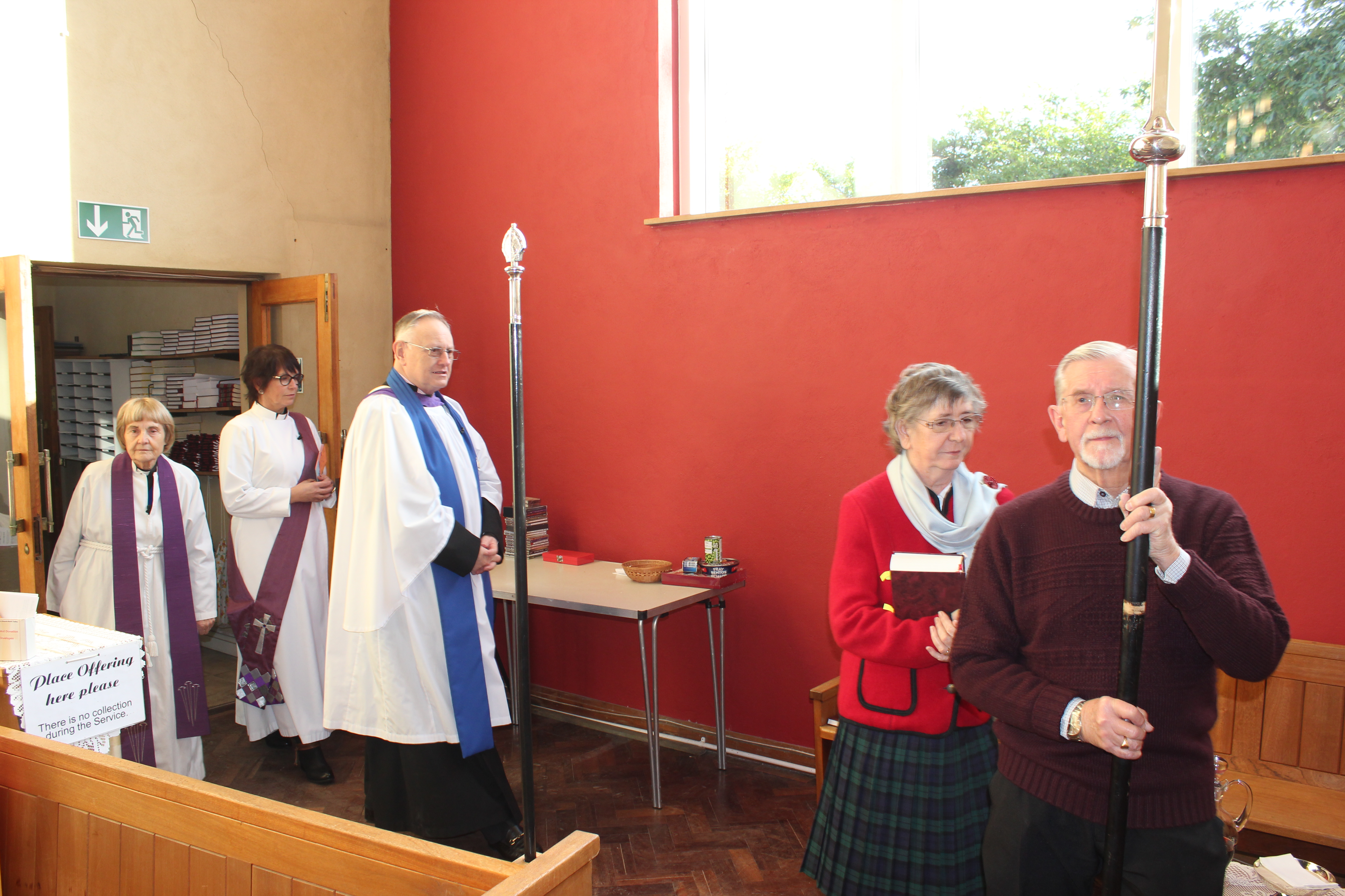 The Cross organist and Clergy