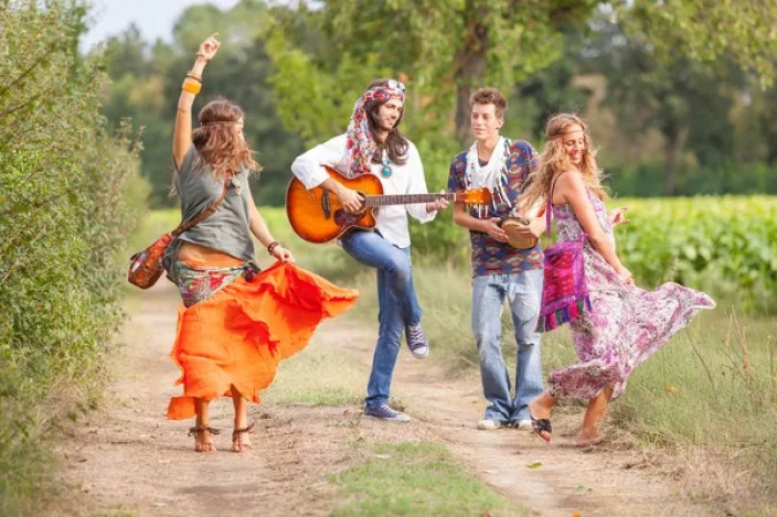 Group of hippies dancing