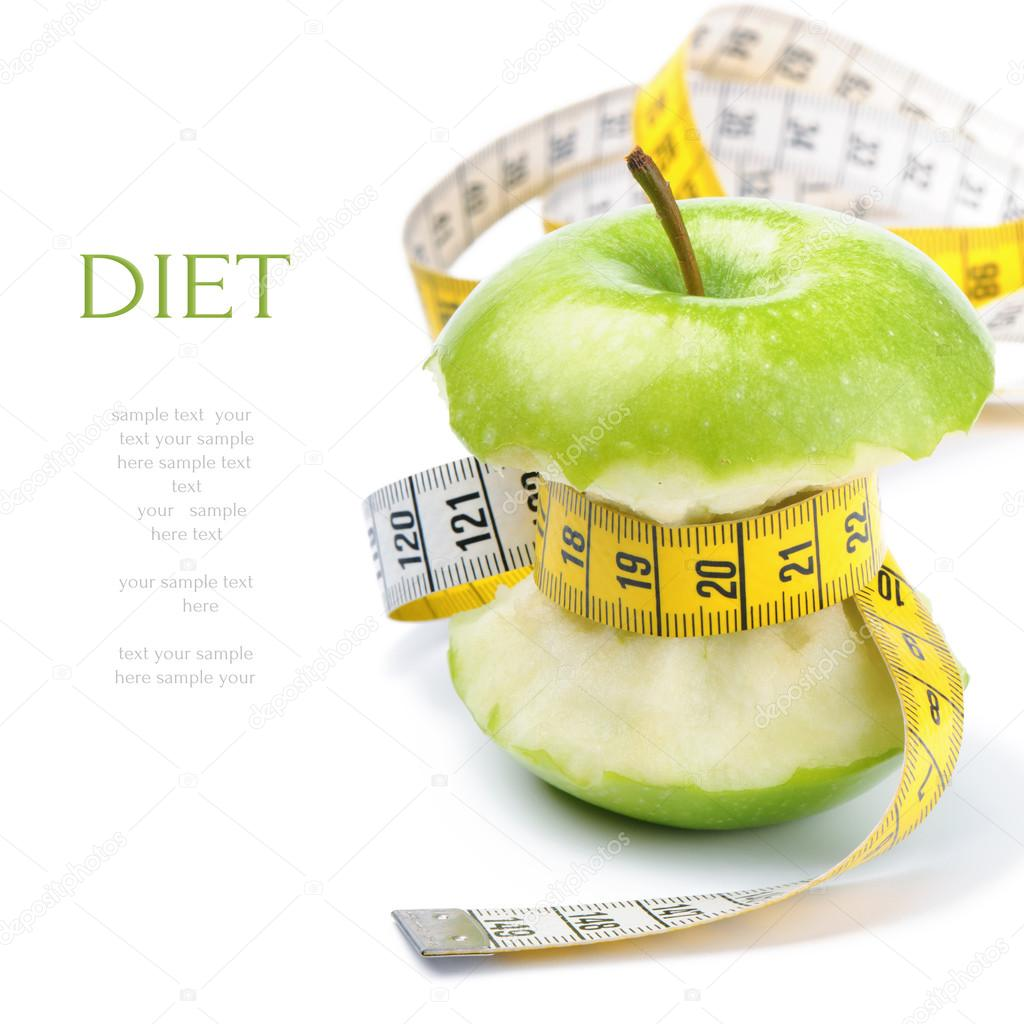 Green Apple Core And Measuring Tapet Concept