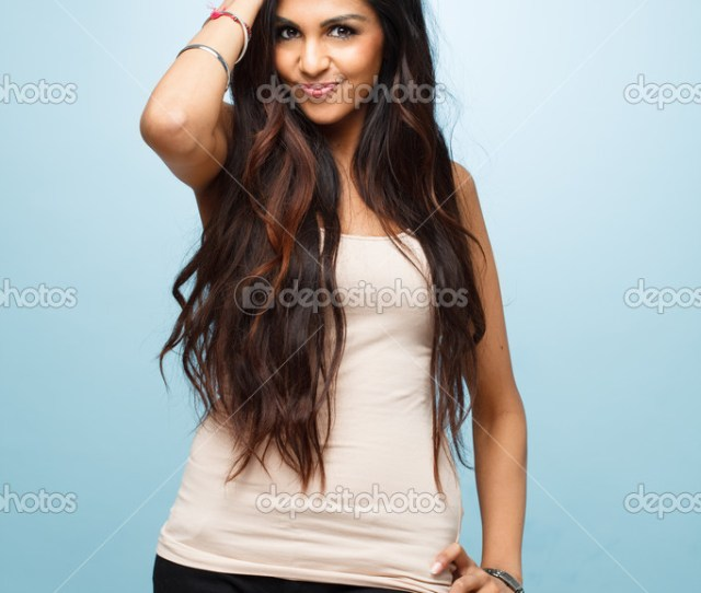 Closeup Indian Cute Teenage Girl Posing For Camera Blue Background Photo By Aila_images