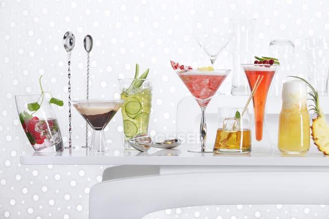 different cocktails on a bar table