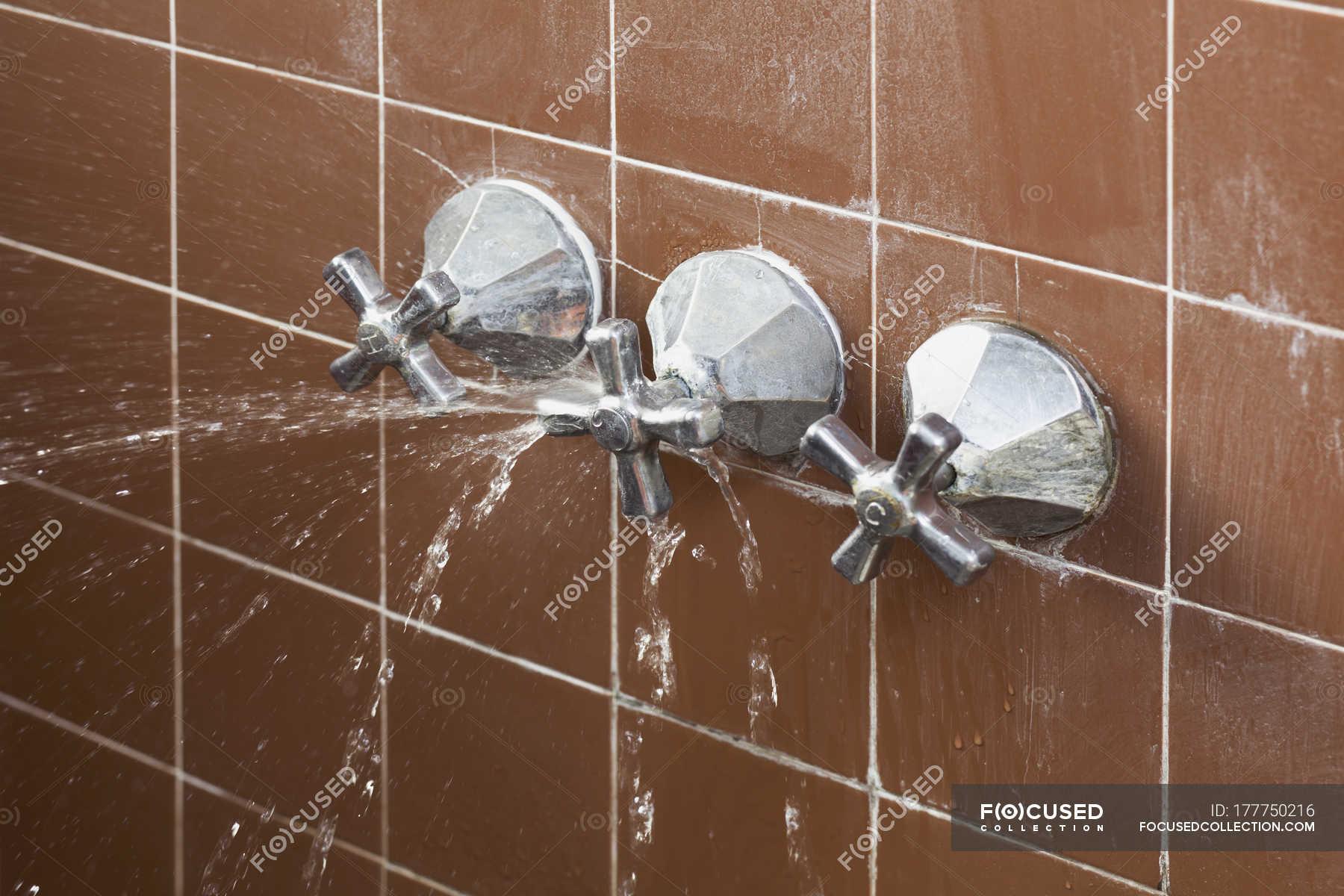 broken shower faucet handle spraying