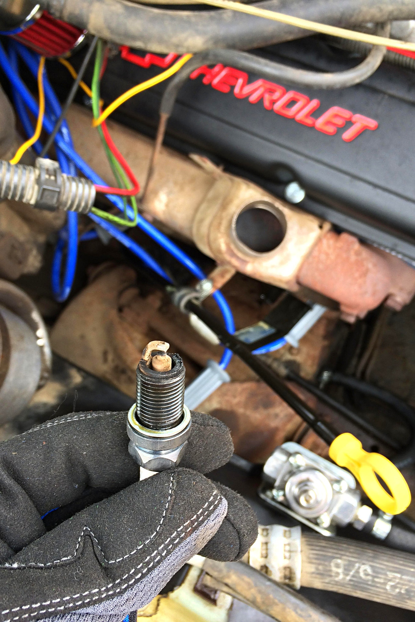 My concerns growing, we stopped at a parts store to buy a spark-plug socket and checked the plugs. The oily buildup and deposits weren't encouraging.