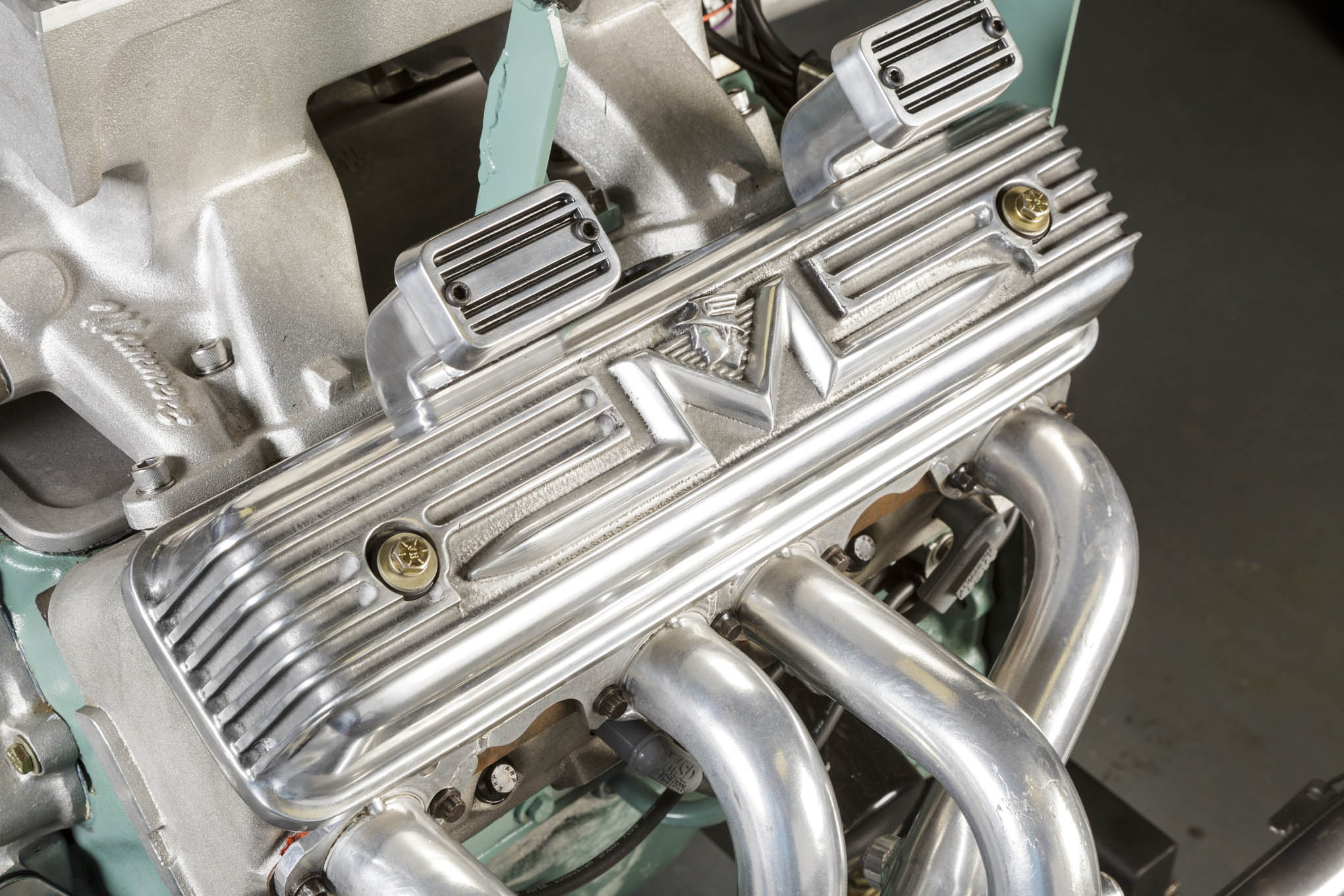This gorgeous set of Mercury valve covers really set Eaton's motor apart form other Y engines in competition. They are the handiwork of Australian manufacturer, Y bloke. Under those valvecovers are shaft-mounted Mummert rockers, working off of an Isky camshaft. Duration for the cam specs in at 256/260 degrees at .050-inches and the lobe separation angle is an extremely tight 102 degrees. The tight LSA helps compress the power and torque bands into the competition's scoring range for maximum points.
