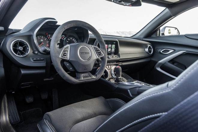 Both the V6 and V8 1LE are equipped with suede steering wheels and short-throw shifters, dual-mode exhausts, and coolers for the engine oil, differential, and transmission.