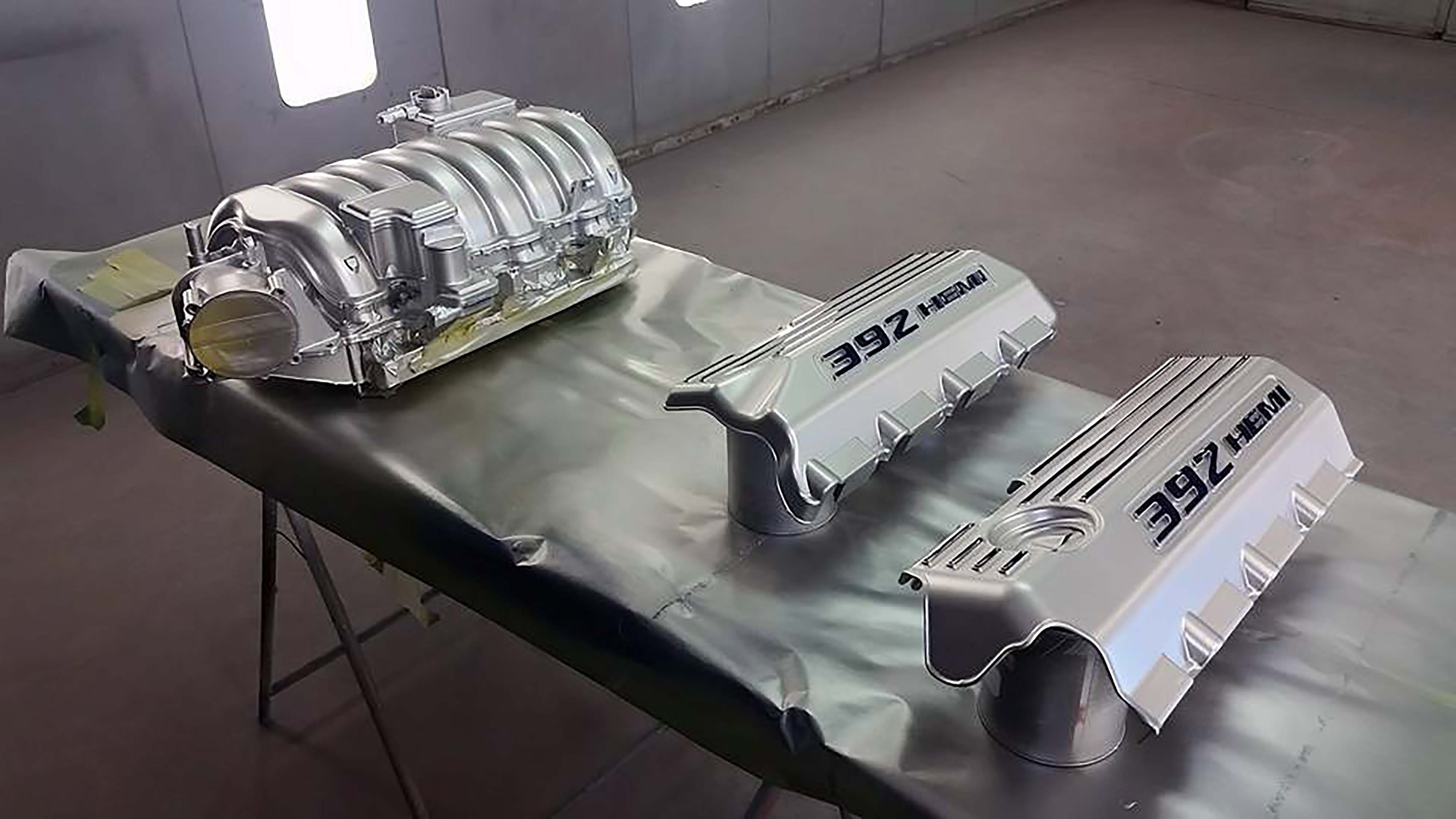 To drop a late-model 6.4L Hemi crate motor into the Charger was a departure from tradition, but during paint, we decided to take it a step further. Webb had a little silver and blue leftover, so we had him paint the intake and coil covers in reverse to the factory, using our car's color scheme.
