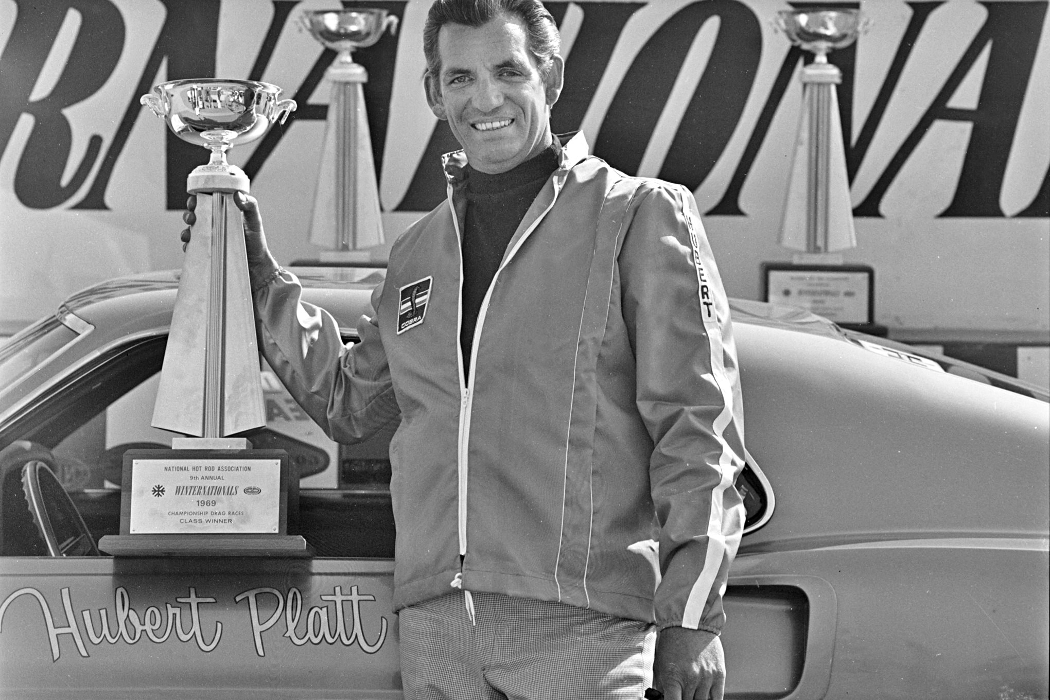 Platt won his class at the 1969 NHRA Winternationals, and your author was on hand to get this photo posing with his trophy.