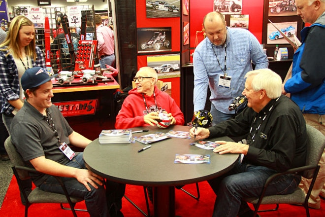 "Ricky Thornton Jr. (left), Mark Martin (center), and Larry Shaw (right) share a laugh during an autograph signing in the Sweet Manufacturing booth.  Just as Thornton sat down, Martin said, ""I've been hearing great things about you.""  The look of shock on Thornton's face was priceless."