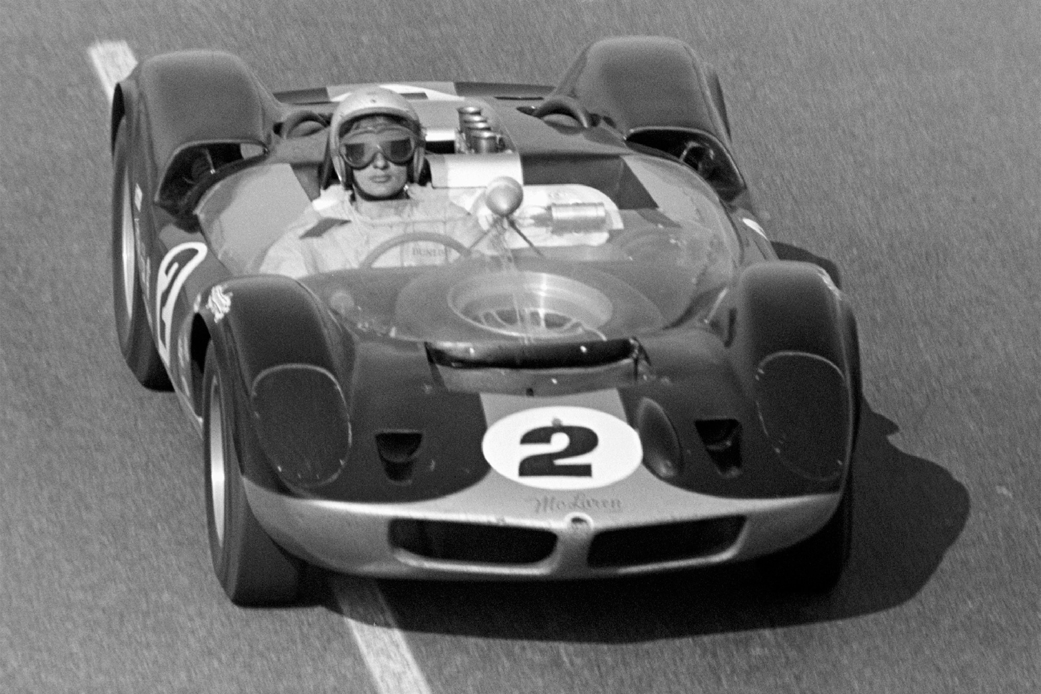 Bob D'Olivo captured 27-year-old Bruce McLaren enroute to winning Riverside's 200-mile qualifying race for the Los Angeles Times Grand Prix, the first victory of a spectacular career. Powered by a Traco-built, all-aluminum Olds F-85 V8, the prototype McLaren-Elva Mark I started on the pole for the next day's main event and led two laps before retiring with breakage. (See Jan. '65 MT.)
