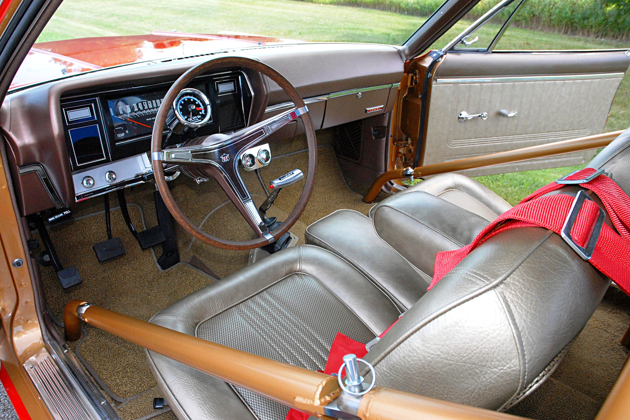 Aherns said one of the toughest jobs was restoring the Rebel's factory gold interior, as most of it had been ripped out or highly modified over the years. In fact, the dash pad itself took two year to re-create. Upholstery is from SMS, while the carpeting is from the nice folks at ACC.