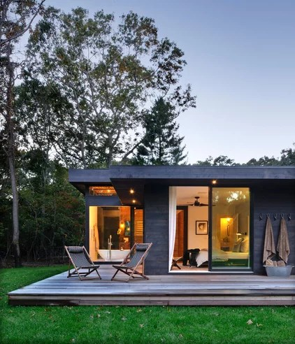 Midcentury Exterior by Bates Masi Architects LLC