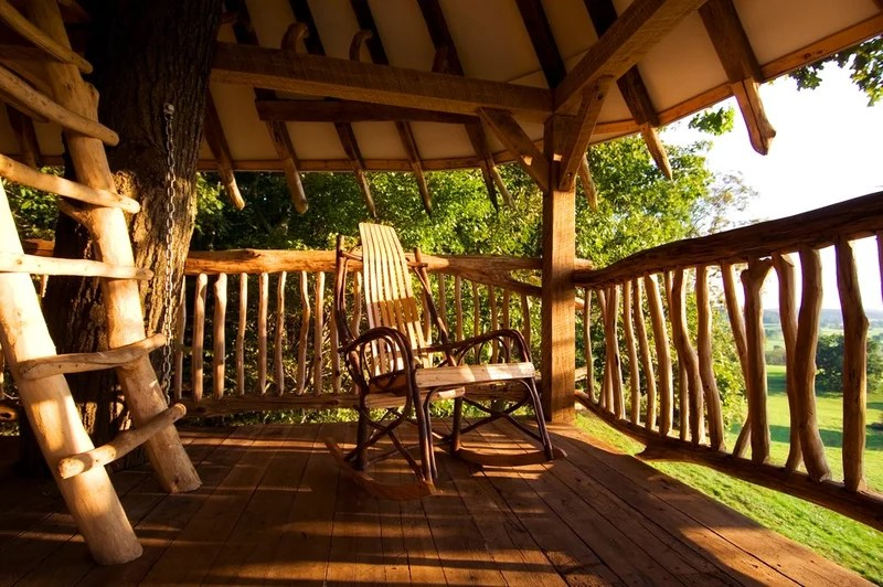 tropical porch by Hugh Lofting Timber Framing, Inc.