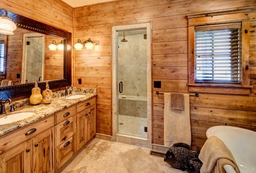 cabin style wood paneled bathroom