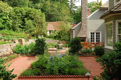 Add bricks at an angle for a different type of garden edging by Houzz featured on Remodelaholic.com