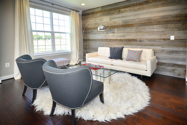 living room with dark wood walls. grey living room with dark wood,
