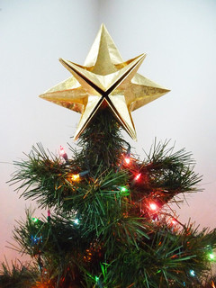 a classic gold star christmas tree topper