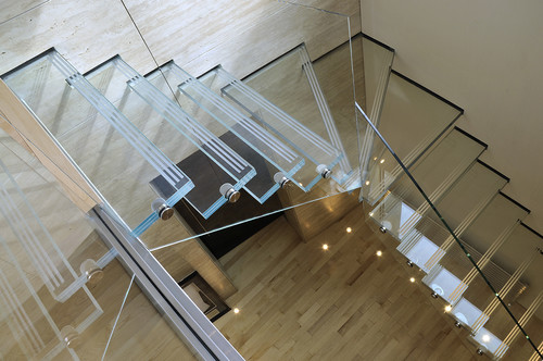 7 Glass Staircases That Will Make You Feel Like Youre