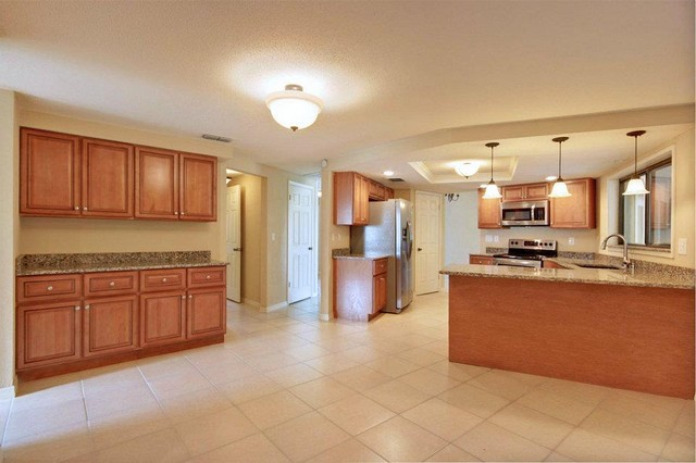 Marquis Cinnamon Kitchen Cabinets Tropical Other Metro