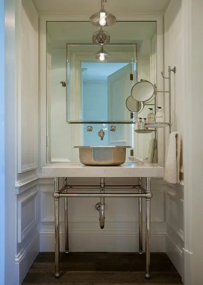 Mediterranean Powder Room by Nance Construction