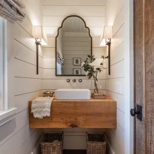 photo of a small farmhouse cloakroom in other with dark hardwood flooring a vessel sink