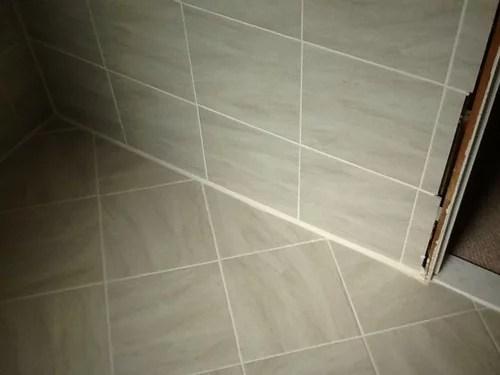 quarter round tile on tile at baseboard