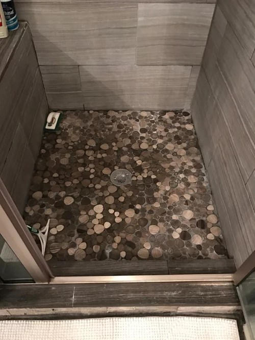 cleaning pebble rock shower basin