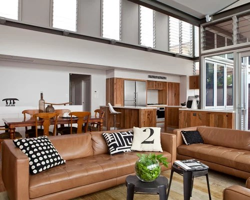 Awesome Living Room Design With Black Leather Sofa Sets Be Equipped Combined White Cushion On