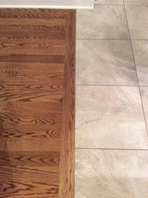 laying carpet over hardwood