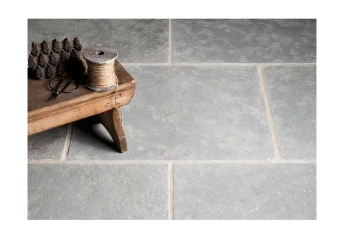 quest for tumbled limestone flooring in