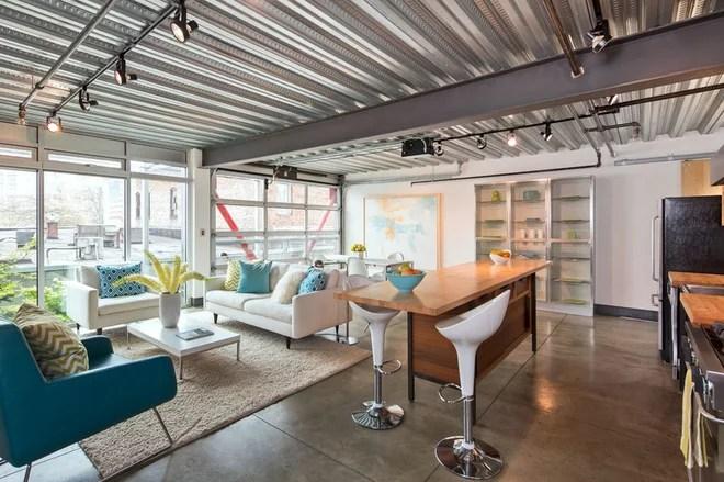 Industrial Living Room by David Robertson Design, LLC