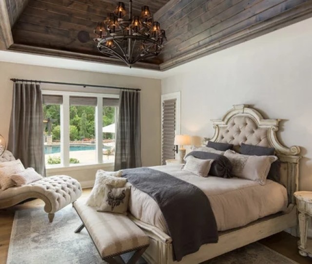 Example Of An Ornate Medium Tone Wood Floor And Brown Floor Bedroom Design In Birmingham With