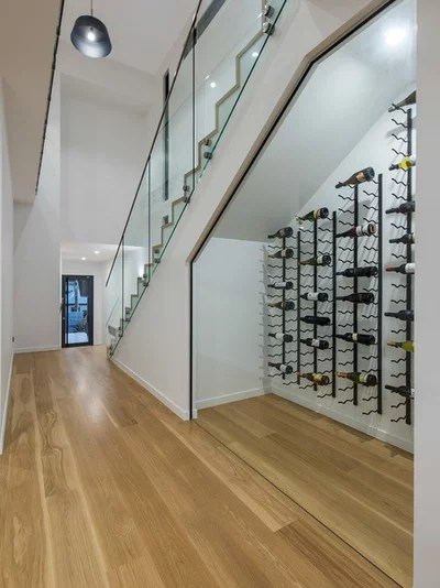 Contemporary Wine Cellar by Lindon Homes Pty Ltd
