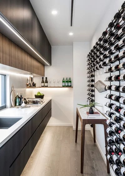Contemporary Wine Cellar by McCarthy Homes QLD