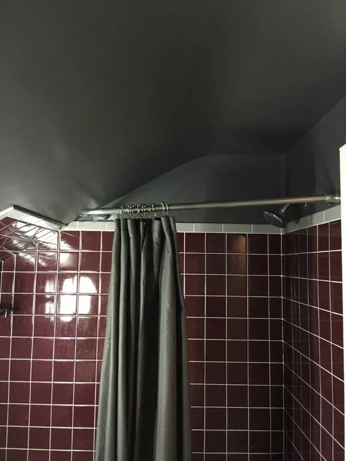 shower rod on sloped ceiling