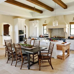 75 Mediterranean Kitchen Design Ideas   Stylish Mediterranean     Mediterranean eat in kitchen designs   Example of a tuscan beige floor eat  in