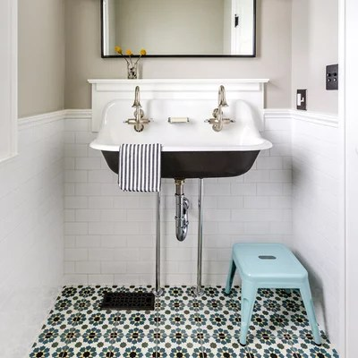 Traditional Powder Room by Designstorms LLC