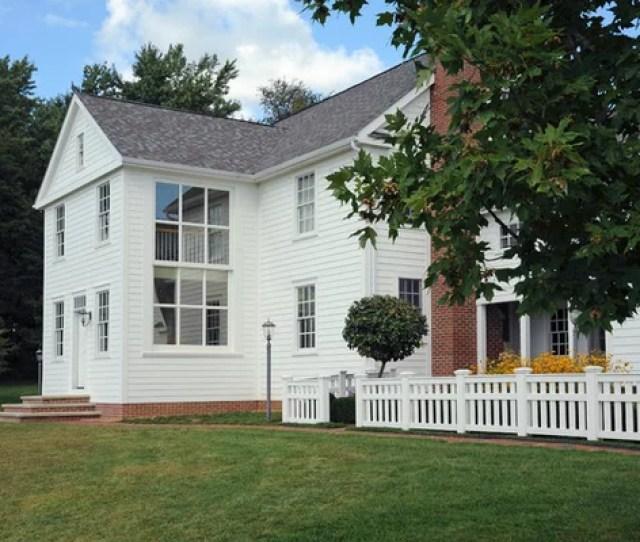 Mid Sized Farmhouse White Three Story Wood Gable Roof Idea In Columbus