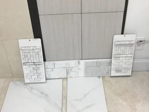 white carrera marble tile in shower